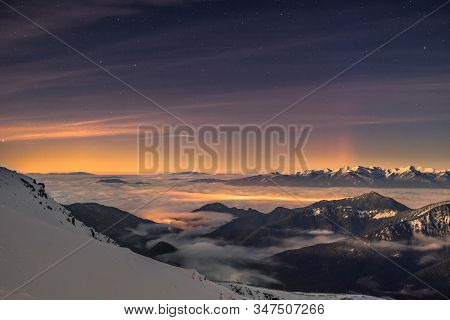 Valley Drenched By Winter Inversion Clouds, Snowy Mountain Landscape, Night Sky, Aurora From Behind