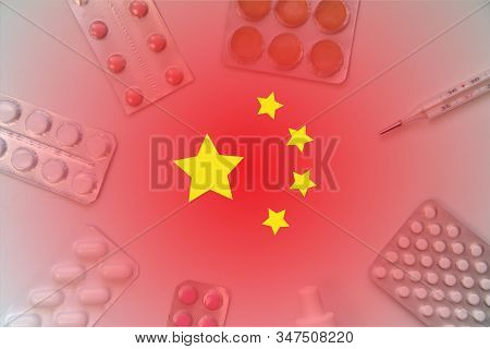Chinese Flag On Background Of Pills And Thermometer. Global Healthcare Concept. Pandemic Virus Infec
