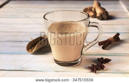 Hot Healthy Indian Golden Milk With Diferent Spices (cardamon, Anice, Cinnamon, Ginger) On A Gray Gr