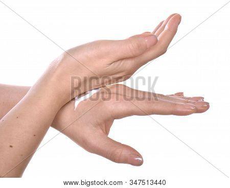Closeup Shot Of Beautiful Female Hands  Applying Moisturiser