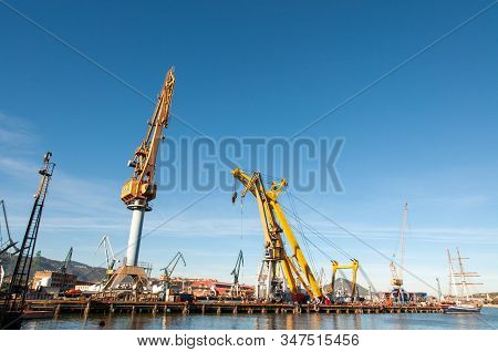 Yellow Towers Crane At Celaya Shipyards In The River Nervion In Erandio, Bizkaia