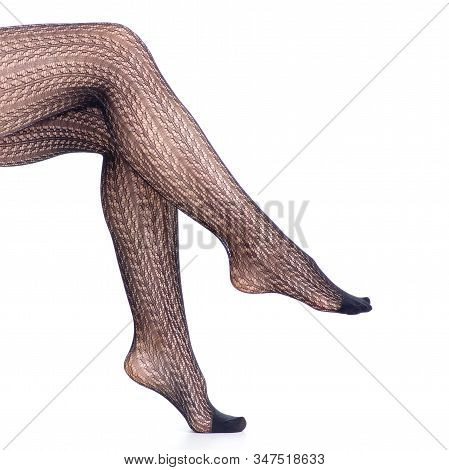 Woman Legs In Black Tights Mesh Pattern Beauty Fashion On White Background Isolation