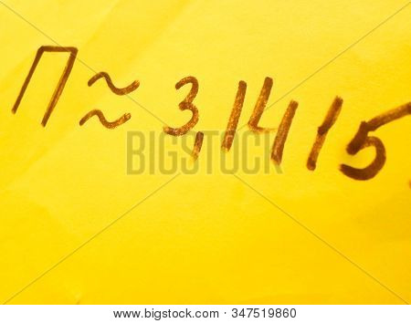 Pi Day - Pi Sign Is Written With Marker For Holiday On March 14, On A Yellow Background, Top View, C