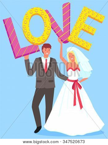 Cute Wedding Couple Holding Colorful Letters Of Word Love. Bridegroom In Black Suit With Red Tie And