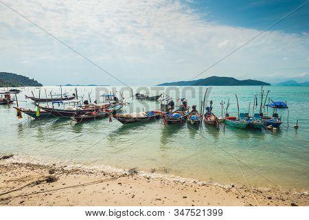 Koh Samui, Thailand - January 2, 2020: Authentic Thai Fishing Boats Docked At Thong Krut Beach In Ta