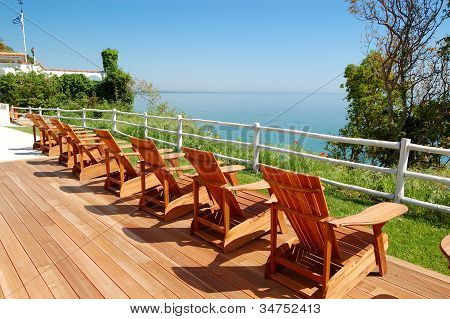 Sea View Area With Wooden Chairs At The Modern Luxury Hotel, Pieria, Greece