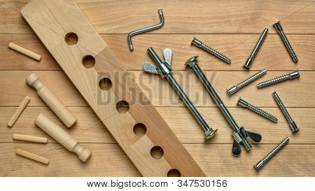 top view background of wood elements and metal hardware for home funiture assembly