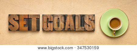 set goals banner in letterpresss wood type with a cup of coffee, goal setting and resolutions concept