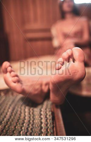 Feet Of A Girl Steamed In A Wooden Bath.