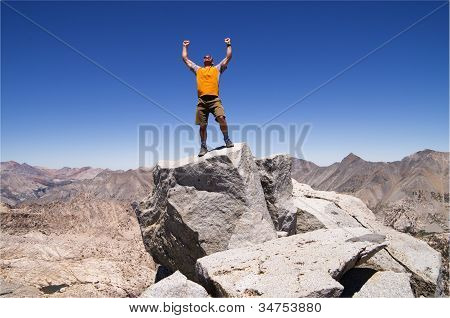a man celebrates his success on the summit of Mount Cotter poster
