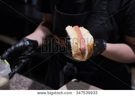 Fresh Hot Dog With Grilled Sausage, Served Outdoors. Cookout American Bbq Food. Hot-dog With Meat An