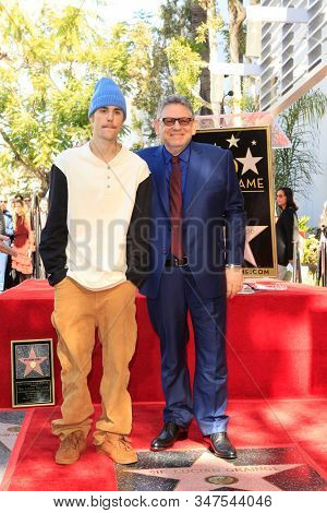 LOS ANGELES - JAN 23:  Justin Bieber, Lucian Grainge at the Sir Lucian Grange Star Ceremony on the Hollywood Walk of Fame on JANUARY 23, 2019 in Los Angeles, CA
