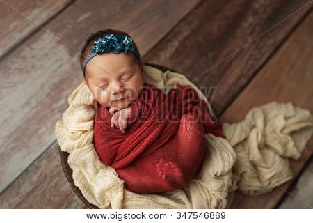 Little Girl In A Beautiful Red Winding And A Headband.