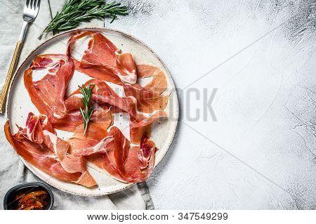 Prosciutto Crudo, Italian Salami, Parma Ham. Antipasto Plate. Gray Background, Top View, Space For T