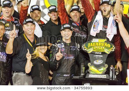 DAYTONA BEACH, FL - JUL 06, 2012:  Kurt Busch (1) holds off the rest of the field to win the Subway Jalapeno 250 at the Daytona International Speedway in Daytona Beach, FL on Jul 06, 2012.