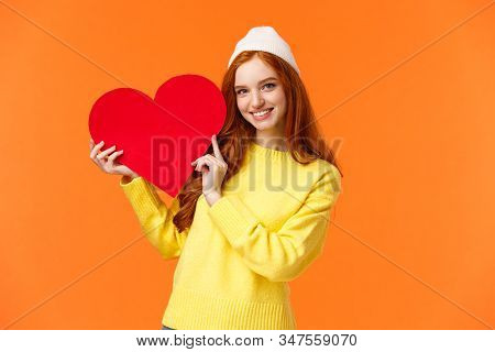 Relationship, Boyfriend Girlfriend And Love Concept. Cheerful Lovely Redhead Girl Holding Big Red He