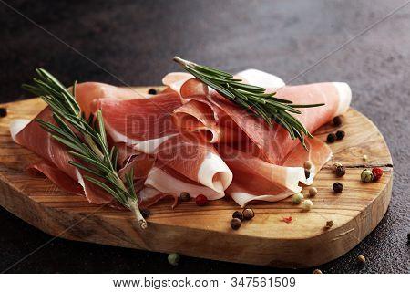 Dry Spanish Ham, Jamon Serrano, Bellota, Italian Prosciutto Crudo Or Parma Ham. Meat Cutting