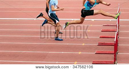 Race Men Athletes Run 110 Meters Hurdles In Athletics Competition