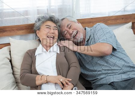 Romantic With Big Smile And Laughing Of Senior Elder Asian Grandmother And Grandfather Sit On Couch