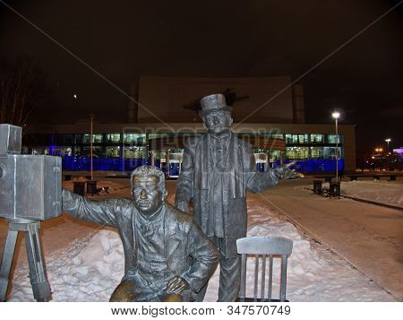 Yekaterinburg, Russia-02/01/2019: Monument To Brothers Lumiere. Night. Next To The Figures Of The Br