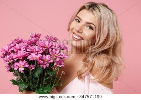 Smiling Young Woman Girl In Party Outfit Celebrating Isolated On Pastel Pink Background. People Life