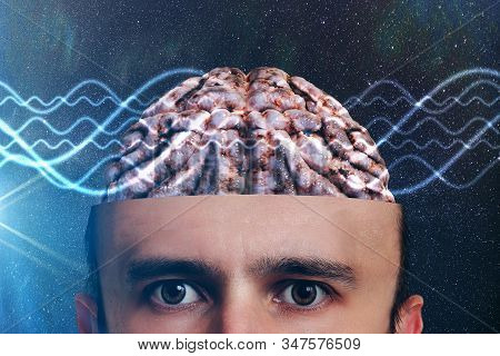 Consciousness And Metaphysics Concept. Waves Go Through Human Head.