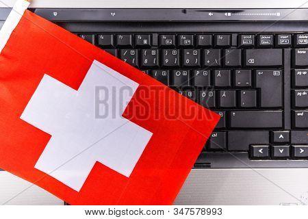 Flag Of Switzerland On Computer, Laptop Keyboard