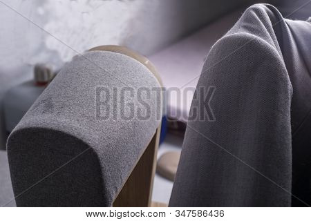 The Process Of Forming The Shoulders Of The Jacket. The Hands Of The Clothing Master, Using The Form