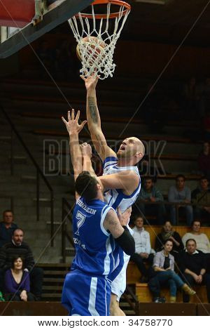 0KAPOSVAR, HUNGARY - FEBRUARY 22: Unidentified players in action at a Hungarian Cup basketball game with Kaposvar (white) vs. Fehervar (blue) on February 22, 2012 in Kaposvar, Hungary.