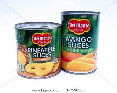 Uk, Jan 2020: Del Monte Canned Fruit Pineapple And Mango On White Studio Background