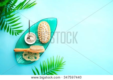 Spa Setting Background With Ready To Use Cosmetic Clay And Massage Brushes, Top Down View Image With
