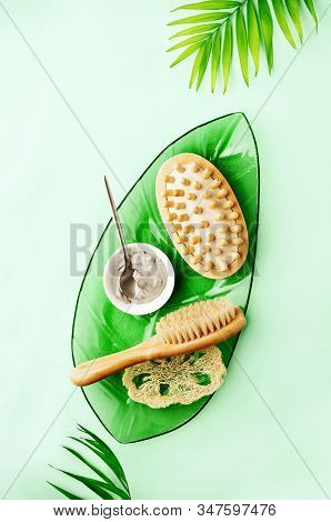 Spa Setting Background With Ready To Use Cosmetic Clay And Massage Brushes, Top Down View Image