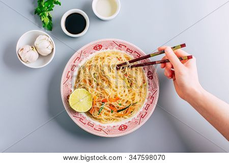 Funchosa Rice Noodles With Vegetables On A Gray Background, Asian Food
