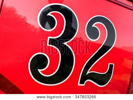 Number 32 On The Door Panel Of A Red Race Car