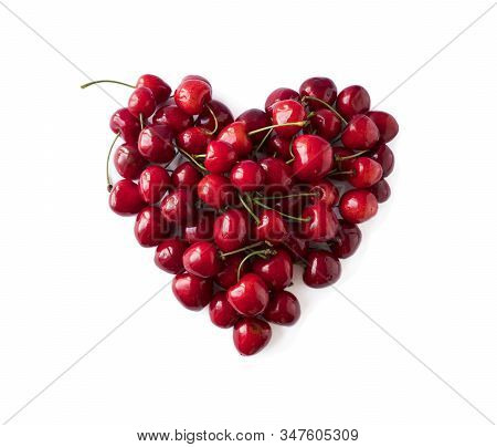 Heart Shape Red Cherries On White Background. Background Made Of Cherry. Sweet Cherry Isolated On Wh