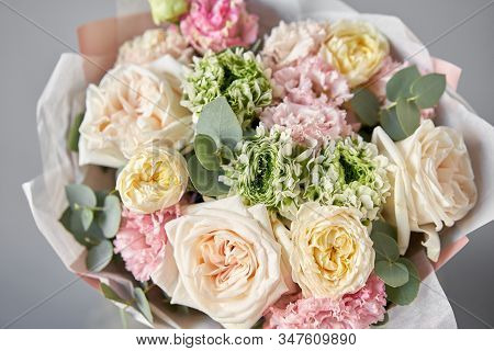 European Floral Shop. Beautiful Bouquet Of Mixed Flowers In Glas Vase. The Work Of The Florist At A