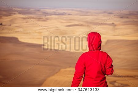 Women With Red Jacket Overlooking The Palouse