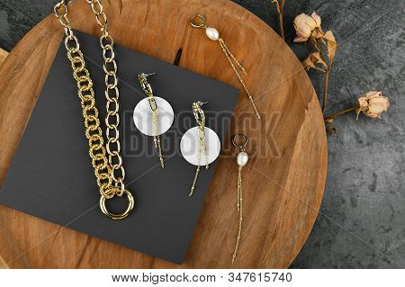 Gold Jewelry On A Wooden Background. Jewelry For All Lovers. Chains On A Wooden Background. View Fro