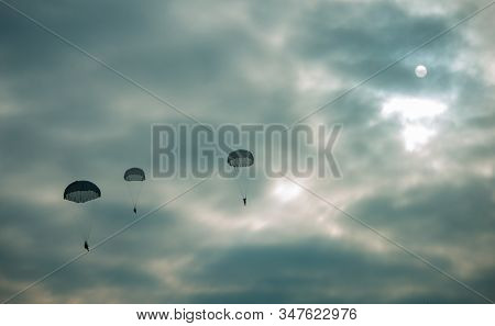 Eight Military Army Paratroopers Jumping At Air War Action