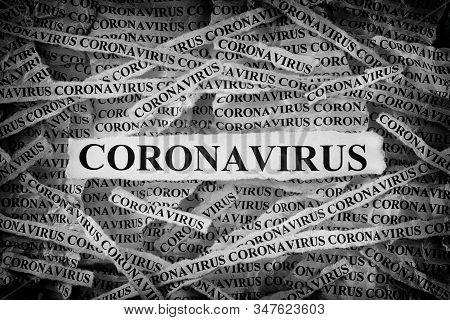Strips Of Newspaper With The Word Coronavirus Typed On Them. Black And White. Close Up.
