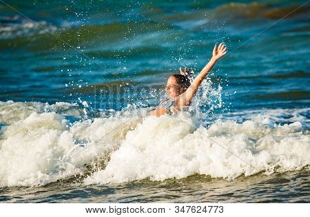 Emotional Little Girl Splashing In The Stormy Sea