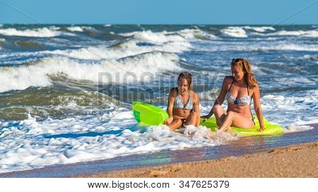 Positive Young Woman And Her Daughter Bathe