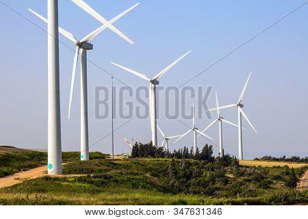 Israel. Modern equipment for generating electric energy. Wind generator - wind farm on Mount Gilboa. Modern windmills