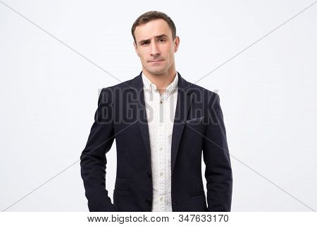 Man In Suit Wears Fashionable Clothes, Raises Eyebrows In Bewilderment, Has To Make Difficult Life C