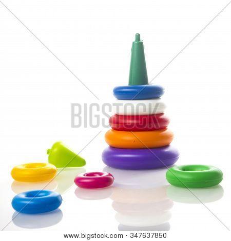 Pyramid Plastic Toy Isolated On White Background