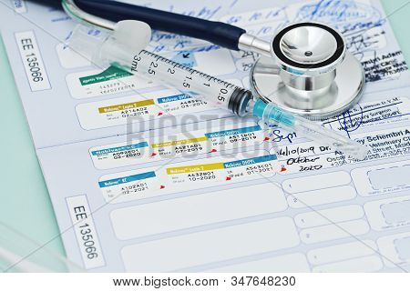 Stethoscope And Pet Animal Vet Passport. Time To Do Vaccination. Concept Of Preparing Pet For Travel