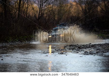 4x4 Travel Trekking. Scene Of Wather Splash In Off-road Racing. Safari Suv. Getting Off The Beaten P