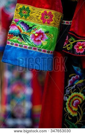 Colorful Detail Of Ethnic Minorities Costume On Display For Sale In Gift Shop In Feng Huang, Hunan P