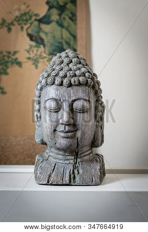 A Sculpture Of Buddah Face For Spiritual And Zen Ambiant