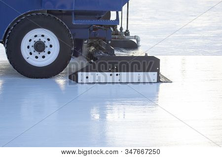 Special Machine For Cleaning Ice On An Ice Rink. Transport Industry. Street Ice Rink Service